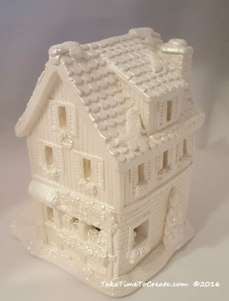 add glitter painted Christmas houses