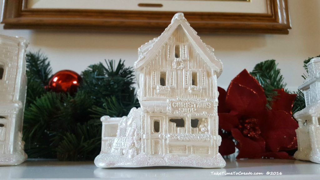 painted Christmas houses on the mantle